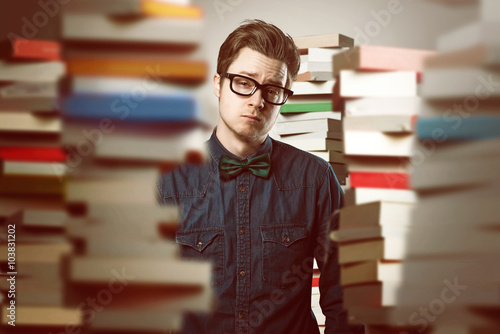 Student between book stacks Canvas Print