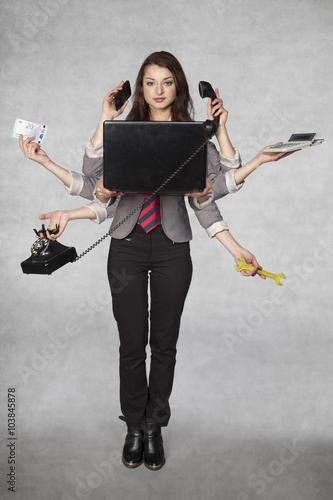 Obraz na plátně  multipurpose business woman on the grey background