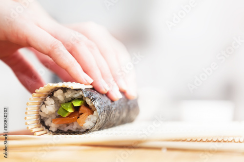 Photo  Preparing, rolling sushi