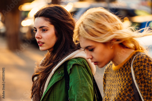 Young women walking outdoors