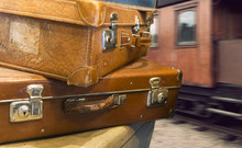 Vintage Suitcases At Train Station