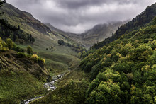 River Valley In The Caucasus Mountains In Cloudy Weather