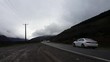 Cars in the famous mountain road Chalus during winter - the foggy and cloudy mountain.