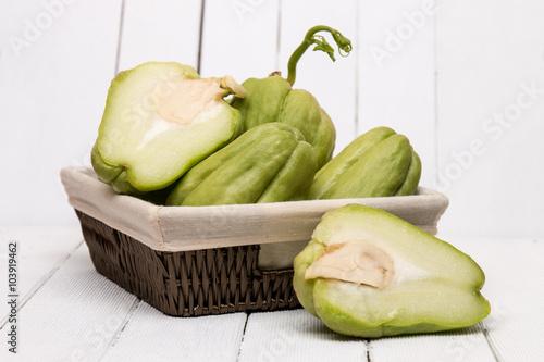Cuadros en Lienzo  Chayote fruit on white wood background