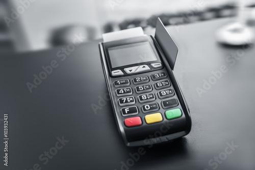 Bank terminal and payment card.
