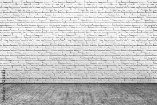 obraz PCV pavimento in cemento e muro in mattoni bianchi