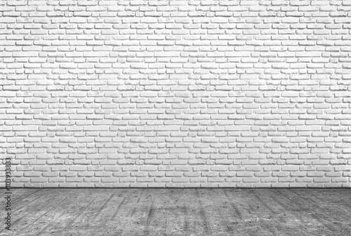 fototapeta na drzwi i meble pavimento in cemento e muro in mattoni bianchi