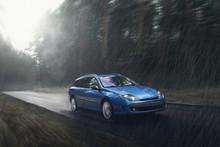 Blue Car Fast Drive On Wet Roa...