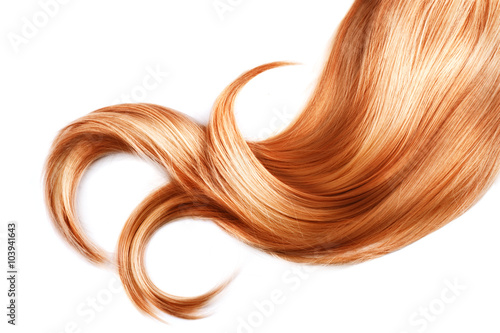 фотографія Lock of red hair closeup isolated over white background