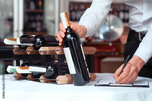 Professional sommelier being involved in work
