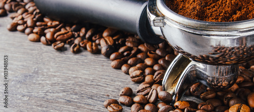 Fotografie, Obraz  Portafilter and Coffee Beans On Wood Background