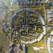Aerial city view with crossroads and roads, houses, buildings, parks and parking lots, bridges. Copter shot. Panoramic image.