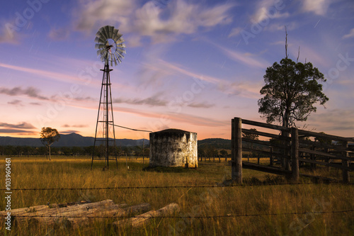 plakat Windmill in the countryside of Queensland, Australia.