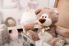 Nursery With A Toy Teddy Bear In A Suitcase