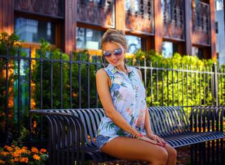 Cute blond girl in sunglass...