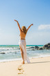 Classy woman walking on the beach Vacation Holiday Concept, Girl