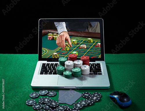 Stampa su Tela Green table with casino chips and cards on notebook