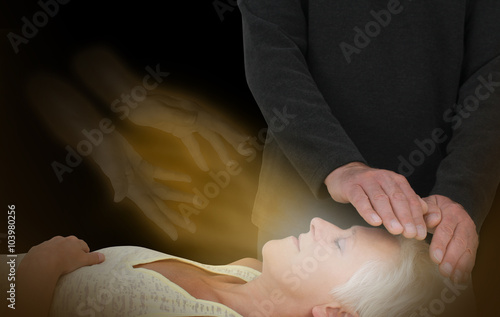 Photo  Spiritual Healing Session -  male healer channeling healing energy to female wit
