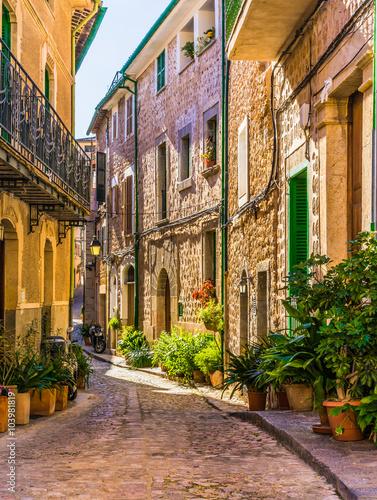 Fototapeta Picturesque street of a old mediterranean village obraz
