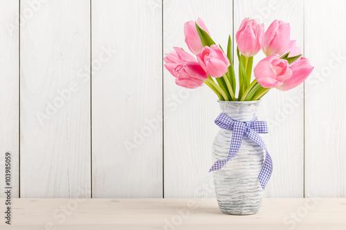 obraz lub plakat Fresh pink tulips in a jug