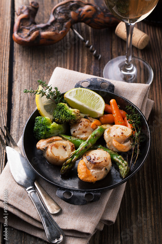 Fried scallops in a sauce with asparagus and broccoli Canvas Print