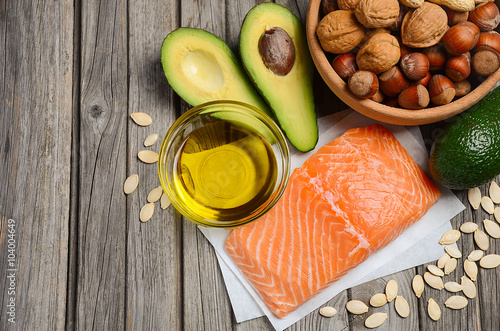 Selection of healthy fat sources. Rustic background. Horizontal permission. Top view. Copy space.