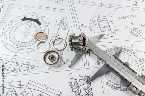 Technical drawing and caliper parts - steel and gear.