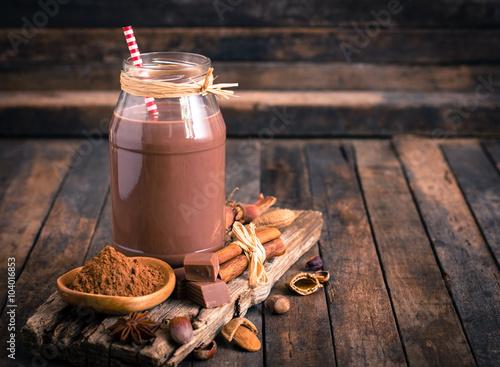 Foto op Plexiglas Chocolade Chocolate milk in the jar