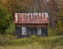Old Wooden Shack: An Abandoned Wooden Shack With Two Windows, One Closed Up Near Peacham, Vermont