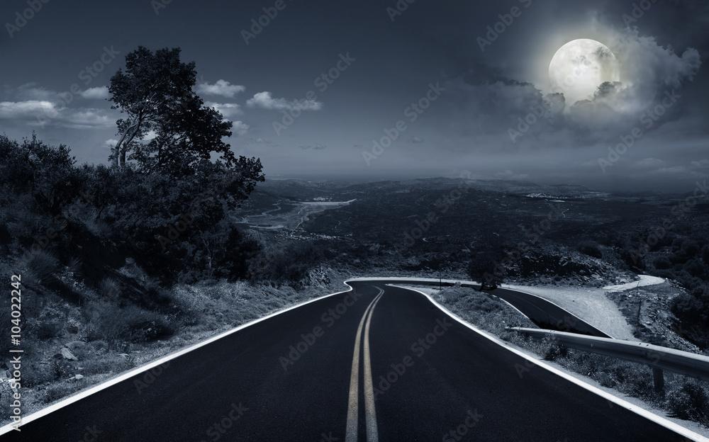 Fototapeta An asphalt road at night