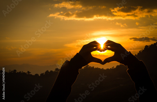 Garden Poster Coral Silhouettes hand heart shaped with sun sets and the sky orange