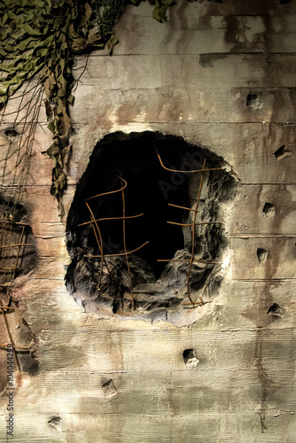 Fotografía Close up of Hole from an artillery shell in German bunker