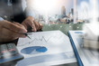 business documents on office table and graph busines