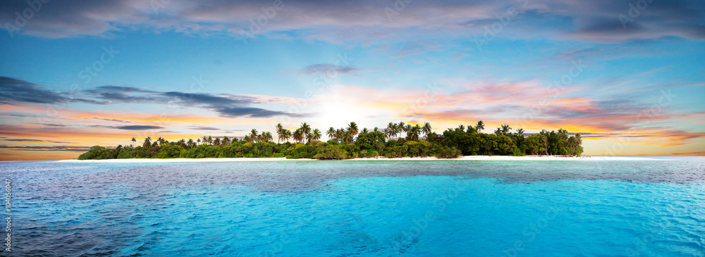 Fototapeta Beautiful nonsettled tropical island in sunset