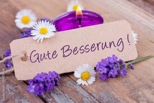 Valokuva  Gute Besserung! Grußkarte mit Lavendelblüten und Kerze