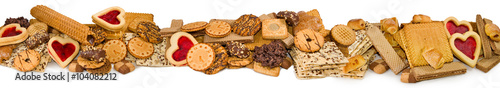 Foto auf Gartenposter Kekse Isolated image of different delicious cookies closeup