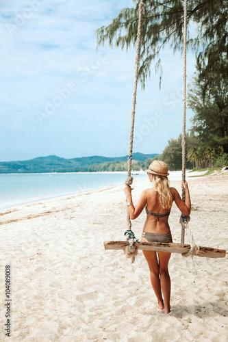 Girl on swing Canvas Print