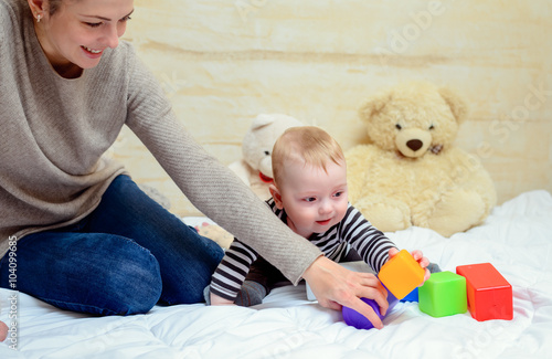 Pretty Mom with her Cute Baby Playing at Home Canvas Print