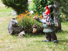 Gnome Holding A Lantern And Smoking A Pipe