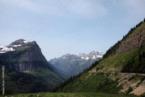 Fotografia, Obraz  The imposing rocky glacial peaks of Glacier National Park in northwest Montana straddle the U