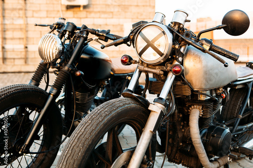 Fotografie, Tablou Two black and silver vintage custom motorcycles cafe racers
