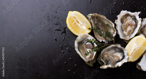Fresh Oysters in shell with lemon