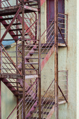 Fototapeta Schody exterior fire escape stairs on manufacturing building