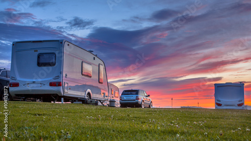 Caravans and cars  sunset Wallpaper Mural