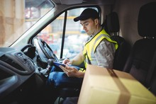 Delivery Driver Using Tablet I...