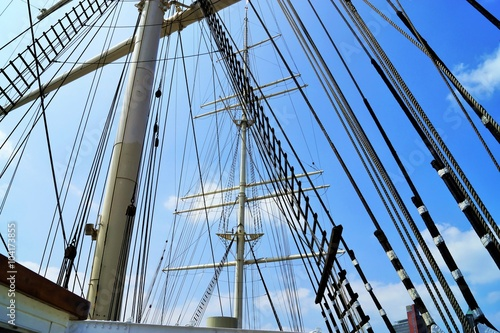 Valokuva  Mainmast of a sailing ship under blue sky
