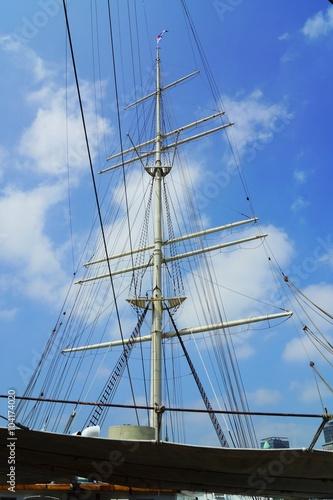 Fotografie, Obraz  Mainmast of a sailing ship under blue sky