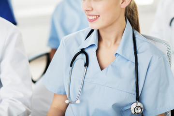 close up of doctor with stethoscope at seminar