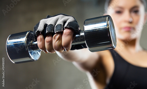 Canvastavla close up of sporty woman with steel dumbbell
