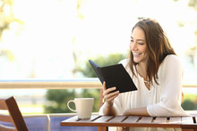 Woman Relaxed Reading A Book In An Ebook